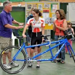 Vicki receiving the new tandem with Adriana looking on