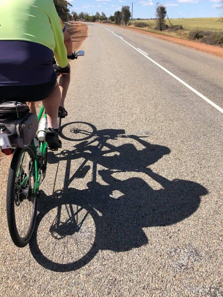 Green tandem bike on the road near Wongan Hills