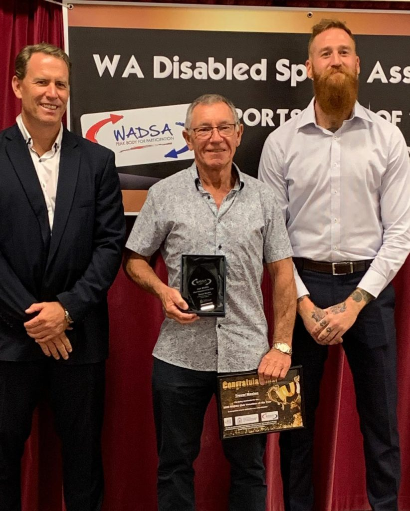 Trevor receiving his award from WADSA