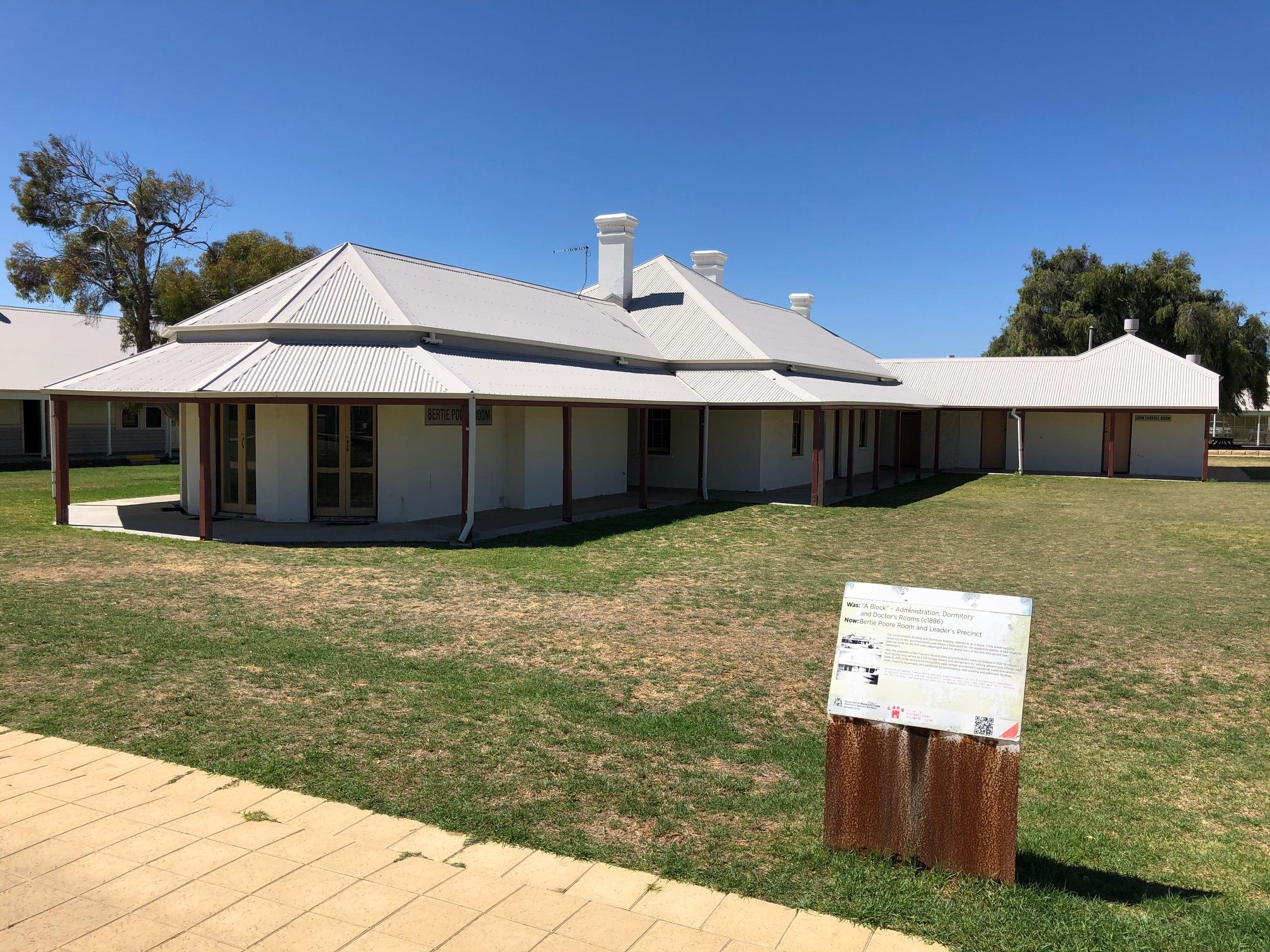 A single story lime wash cream stone building with three chimneys and wide verandahs is set amongst lawn. It originally included the quarantine station's medical officer residence and dates to around eighteen eighty six.