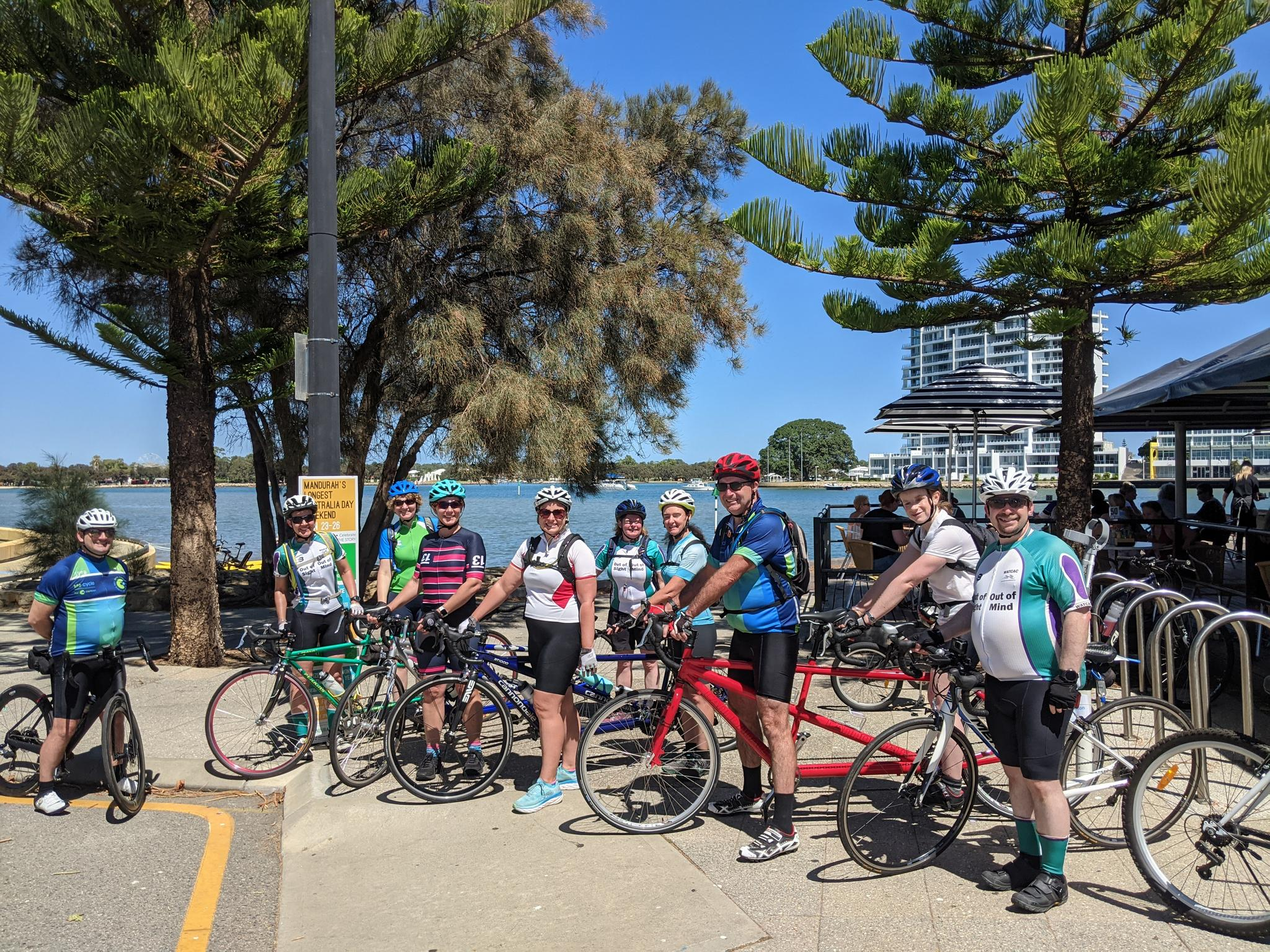 A group of 10 riders comprised of four tandems and two single bikes mount up outside a cafe stop on the Mandurah foreshore in preparation for the ride home. Despite the warmth favourable winds enabled riders to complete 112 km.